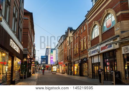 NOTTINGHAM ENGLAND - AUGUST 30: Frontage of Footasylum Sports Direct and other stores at night on Clumber Street. In Nottingham England. On 30th August 2016.