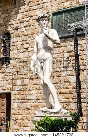 Florence, Italy - May 26, 2016: The copy of famous scuplture of David by Michelangelo near Vecchio palace in Florence