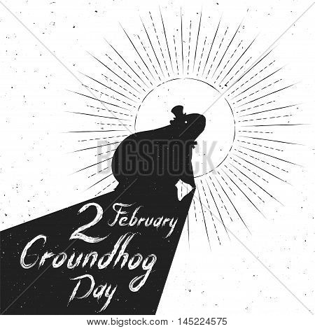 Groundhog Day greeting card. Hand-written lettering on vintage grunge background. Groundhog Day emblem with the silhouette of a marmot in a retro style.
