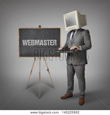 Webmaster text on blackboard and computer monitor on businessman head