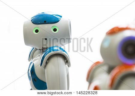 Small Robots With Human Face And Body. Ai