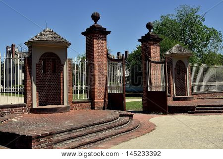 New Bern North Carolina - April 24 2016: 1770 Tryon Palace Entry Gate with dual sentry booths