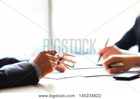 Banking business or financial analytics desktop with accounting charts pen and glasses