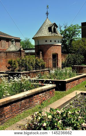 New Bern North Carolina - April 24 2016: Raised brick planting beds with dovecote in the gardens at 1770 Tryon Palace