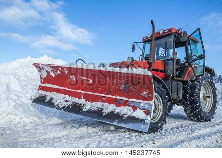 Big snow plow in opeeration on snowy mountain road