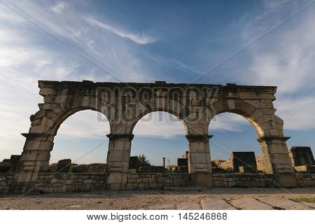 Antic archway at the roman ruins of Volubilis in Morocco at the area of Fes Meknes.