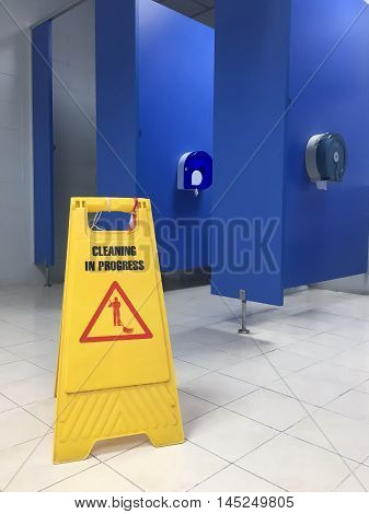 Caution wet floor. Cleaning in progress. A yellow sign warning for the area was cleaned.