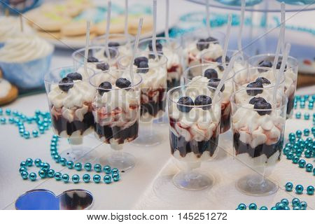 Candy bar on wedding ceremony with a lot of different candies and sweets