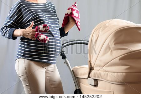 Pregnant woman. In anticipation of motherhood. Pregnant belly