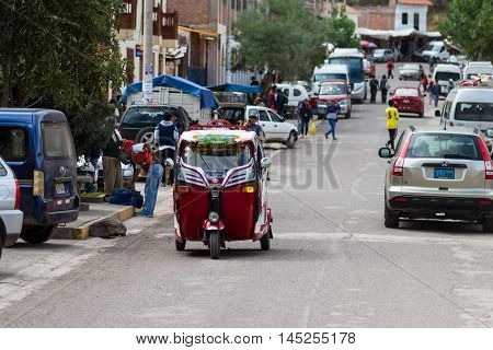 Pisac Peru - May 15: MotoTaxi a small compact vehicle making its way thru the streets of Pisac. May 15 2016 Pisac Peru.