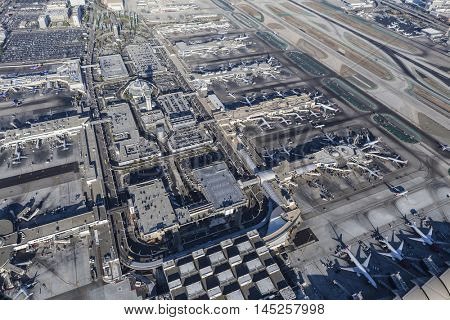 Los Angeles, California, USA - August 16, 2016:  Aerial view of Los Angeles International Airport roads, garages, terminals, airplanes and runways.