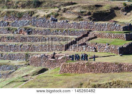 Tour Group Exploring Inca Terraces