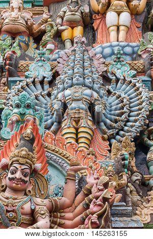 Madurai India - October 19 2013: Closeup of Shiva avatar Maha Sadashiva Murthy with twenty-five heads. Facade of South Gopuram at Meenakshi Temple.