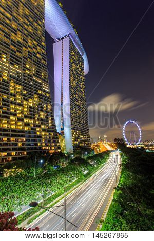 SINGAPORE-JUNE 26: Day view of The Supertree Grove Cloud Forest & Flower Dome at Gardens by the Bay on Jun 26 2015 in Singapore. Spanning 101 hectares and five-minute walk from Bayfront MRT Station.