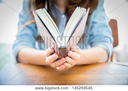 close up woman hand holding pocket book to read.