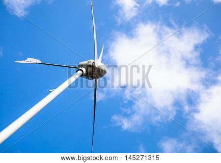 View From Below Of A Windmill For Electric Power Production. Outdoors.