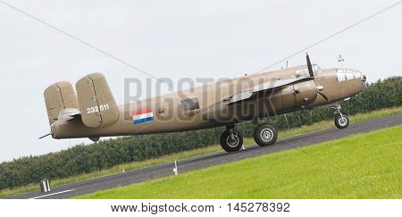 Leeuwarden, The Netherlands - June 10: Ww2 B-25 Mitchell Bomber In Dutch Markings Take Off During Th