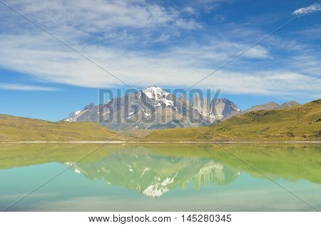Reflection on the lake of Torres del Paine national park at South America, Chile