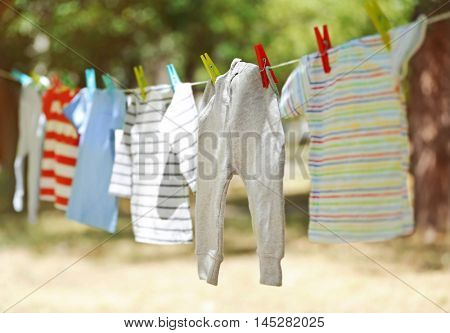 Baby laundry hanging on clothesline