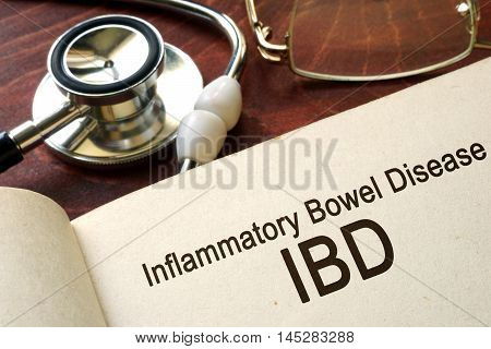 Book with words inflammatory bowel disease IBD on a table.