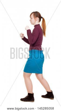skinny woman funny fights waving his arms and legs. Rear view people collection.  backside view of person.  Isolated over white background. girl in a blue skirt and a burgundy sweater fights with