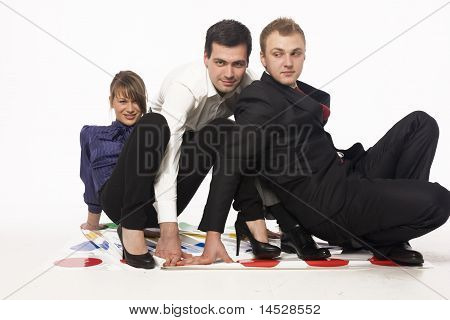 Business people playing twister
