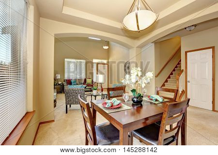 Open Floor Plan. Dining Area And Living Room With Entryway