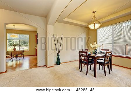 Open Floor Plan Dining Room Interior In Creamy Tones.
