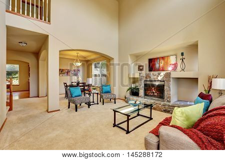 Cozy Luxury Family Room With High Ceiling And Arched Doorway
