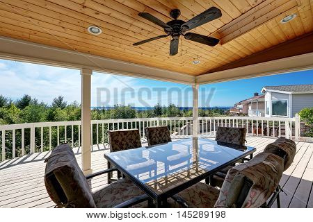 Large Wooden Walkout Deck With Flat Roof Extension