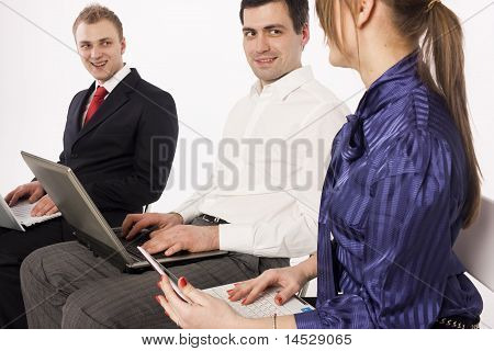 Office managers working with laptops