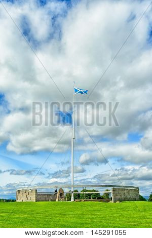 BANNOCKBURN SCOTLAND - August 29 2016: The Rotunda and Saltire flagpole at the Battle of Bannockburn visitors attraction Bannockburn Stirlingshire Scotland.