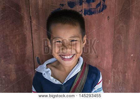 MAE KAM PONG MAEHONGSON THAILAND - October 10: unidentified children Karen hill tribe is smiling in the cottage of northern Thailand on October 10, 2015 in Maehongson Thailand.