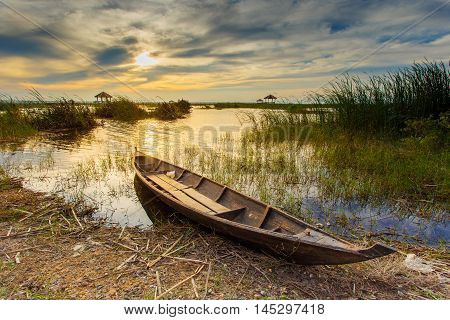 Fishing boat in lotus lake at khao sam roi yot national park Thailand