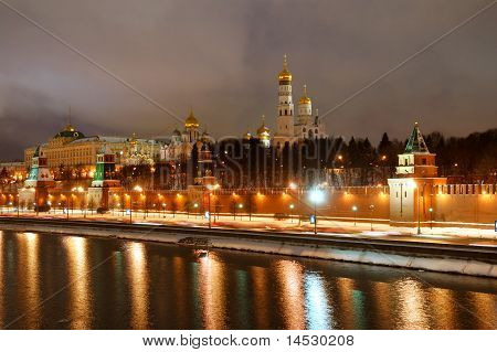 Moscow Russia February 07 2011. Panorama of Moscow Kremlin and Moskva river in a winter night. Bbright illumination of Kremlin wall towers and orthodox church. poster
