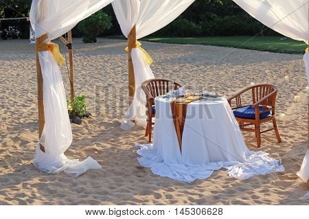 Tent and a table for a romantic dinner on the beach