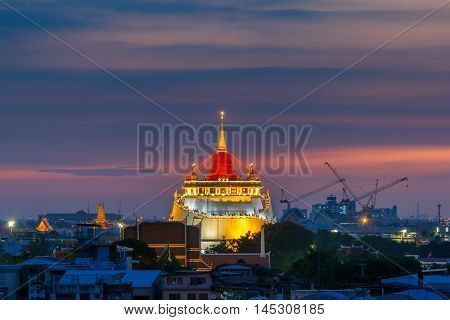 Golden Mount Temple Fair Golden Mount Temple with red cloth in Bangkok at dusk (Wat Sraket Thailand)