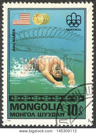 MOSCOW RUSSIA - CIRCA AUGUST 2016: a stamp printed in MONGOLIA shows John Naber the series