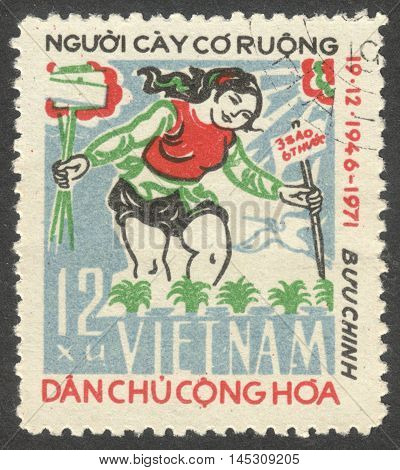 MOSCOW RUSSIA - CIRCA AUGUST 2016: a stamp printed in VIETNAM shows Land To The Tillers the series