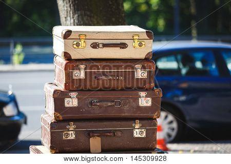 The vintage suitcases on a flea market