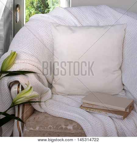 Pillow case Mockup. White pillow on an armchair in the room.