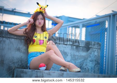 Bangkok, Thailand – August 24,2016:  Trainer  Girl   Playing Pokemon , Pokemon Ball