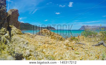 rocks by the sea in Capo Coda Cavallo Sardinia