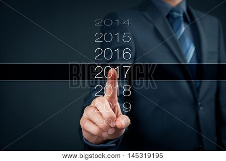 Businessman welcome year 2017. Business new year card concept.