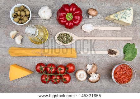 Healthy pasta ingredients arranged on a wood background