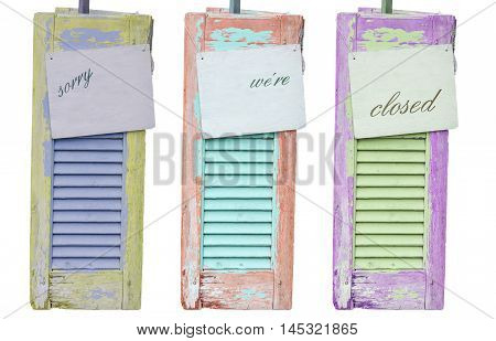 Three old decorative weathered wooden shutters with inscription Sorry were closed