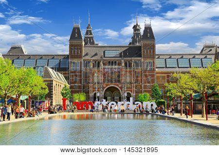 Amsterdam, Netherlands - May 13, 2016: Rijksmuseum museum on May 13, 2016 in Amsterdam. Words I Amsterdam in front of the Rijksmuseum is a  popular touristic destination in Amsterdam