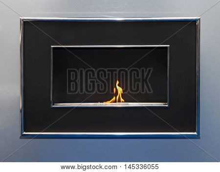 Oil Burning Flames in Contemporary Metal Fireplace