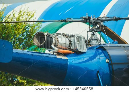 Helicopter blue. Visible and turbine blades close-up.
