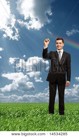 businessman writting something with marker in air outdoors poster